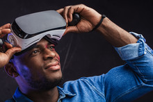 African Male Architector Taking Off His Virtual Reality Headset Looking Around, Can Not Believe That It Is Only Digital Images, And His And His Skillfully Built House Does Not Yet Exist In Reality.