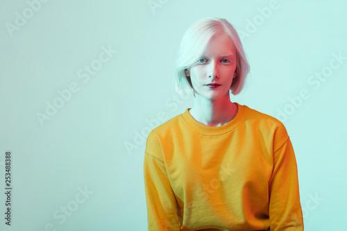 Valokuva  beautiful albino girl with white skin, natural lips and white hair wearing styli