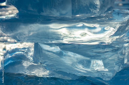 Foto op Aluminium Fantasie Landschap Pieces of clear blue ice of lake Baikal in the winter sunlight. Beauty of nature
