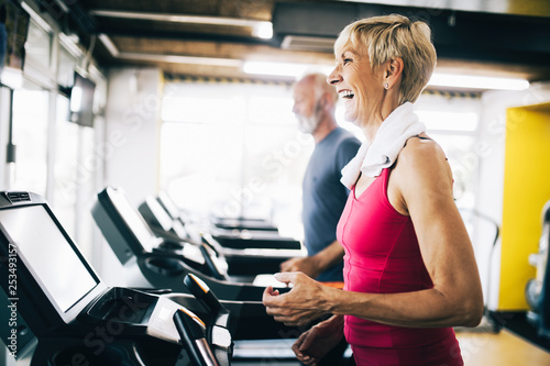 Poster Fitness Picture of senior people running on treadmill in gym