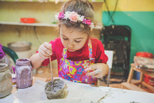 Little Girl At Pottery Worksho...