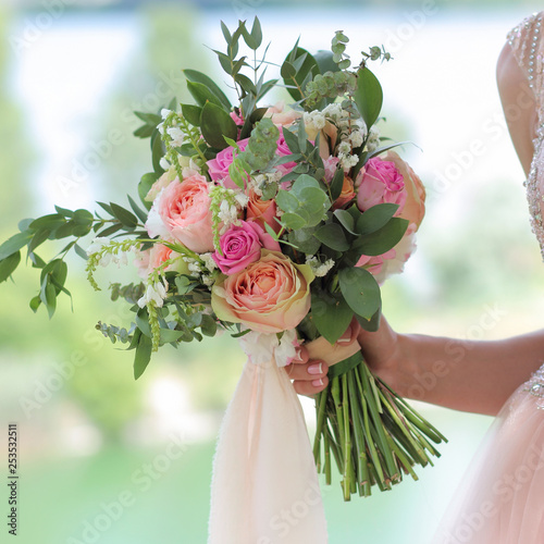Fotografie, Obraz Beautiful bridal bouquet in hands of the bride