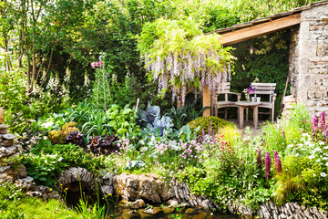 FototapetaDecorative garden with a patio area in a countryside
