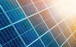 Leinwandbild Motiv Close-up surface of lit by sun blue shiny solar photo voltaic panels. System producing renewable clean energy. Renewable ecological green energy production concept.