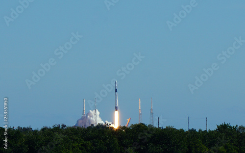 Rocket launch on a clear blue sky cloudless day.