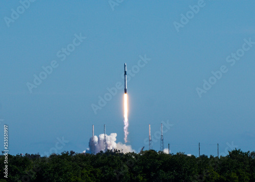 Deurstickers Nasa Rocket launch on a clear blue sky cloudless day.