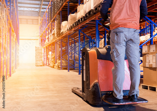 Fotografie, Obraz  man worker with electric forklift working in warehouse.