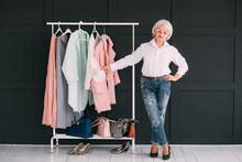 Senior Lifestyle. Fashion Clothes Shopping. Confident Elderly Lady Showing Stylish Wardrobe.