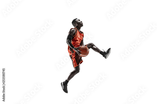Obraz na plátne  Full length portrait of a basketball player with a ball isolated on white studio background