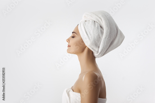 Leinwand Poster Beautiful young woman after bath on white background