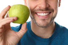 Man With Perfect Teeth And Green Apple On White Background, Closeup