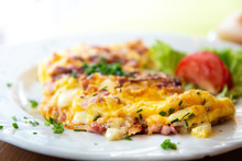 Omelet With Ham Tomato And Gre...