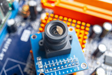 Camera With Lens On Electronic Integrated Circuit Board. Concept Of High Technology And Robotics