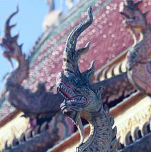 A Rooftop Dragon Sculpture At A Neighborhood Temple, Chiang Mai, Thailand