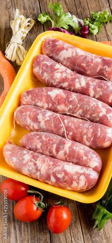 pork sausages in polystyrene pan Canvas Print