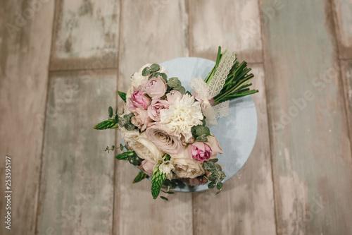 Valokuva  Beautiful bridal bouquet of powder roses.