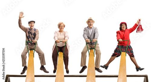 Photo  Cheerful senior people having fun on a seesaw