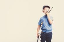 Cute Little Police Boy With Smile On Face And Baton On White Background. Intelligent Cool Children In Police Suit With Blue Eyes And Baton Use Radio Walkie Talkie