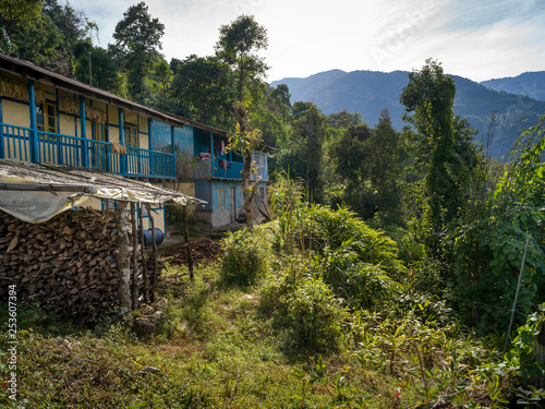 Huts in a village with mountain range in the background, Dentam Forest Block, Radhu Khandu Village, Sikkim, India
