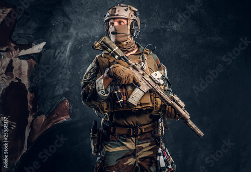 Elite unit, special forces soldier in camouflage uniform posing with assault rifle Wallpaper Mural