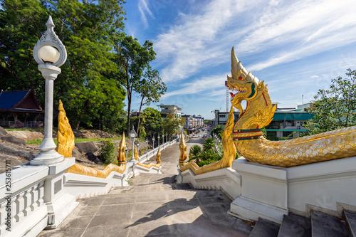 Obraz Authentic staircase to Wat Kaew Korawaram white temple in Krabi Town in Thailand - fototapety do salonu