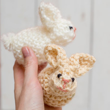 Soft Knitted Easter Bunnies In Hand. Easter Diy Decoration