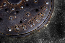 Sewer Cover Man Hole Iron Grate On Street In City