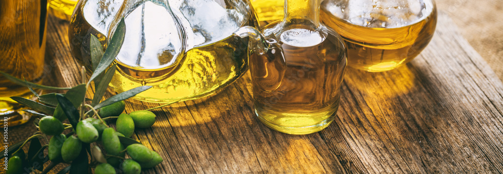 Fototapety, obrazy: Olive oil in glass bottles on wooden table, banner, closeup view