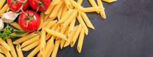 Penne Rigate Pasta, Tomatoes, Garlic And Basil On Black Background, Banner