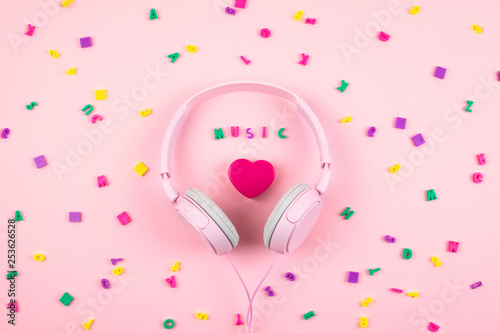 Pink headphones and heart with word MUSIC and multicolored letter