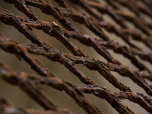 Rusty, Corroded Metal Mesh Fence, Closeup At Angle