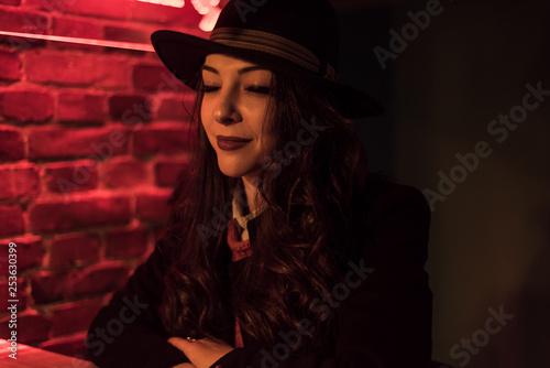 Fotografie, Tablou  brunette with a black hat closing her eyes