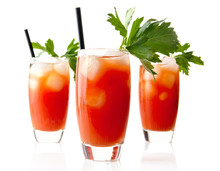 Red Bloody Mary Drinks With Ice Cubes With Celery Isolated On White
