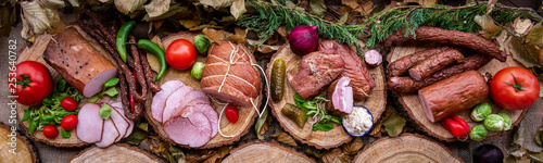 Fototapeta Assortment of cold meats: sausages, ham, bacon obraz