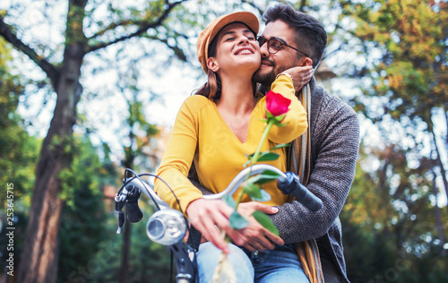 Couple in love. Romantic couple riding a bicycle in the park. Love, dating,  romance Stock Photo | Adobe Stock