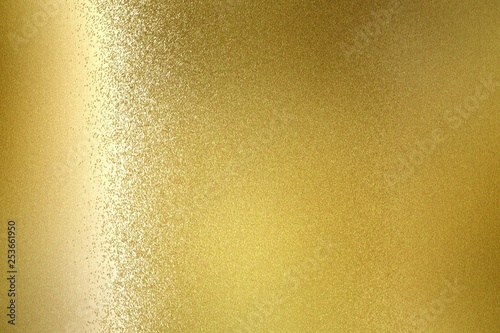 Fotografía  Glowing gold metallic wall, abstract texture background