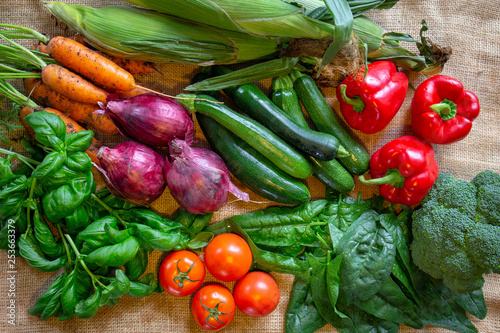 Fotobehang An assortment of fresh and healthy vegetables in season from the garden in summer