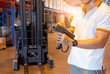 Young man worker hand holding barcode scanner with inventory the product in warehouse factory.