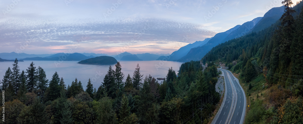 Fototapety, obrazy: Aerial panoramic view of the scenic highway surounded by the Beautiful Canadian Mountain Landscape during a summer sunrise. Taken in Sunset Beach, North of Vancouver, British Columbia, Canada.