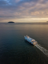 Aerial View Of A Ferry Boat In The Ocean During A Vibrant Cloudy Sunset. Taken In Horseshoe Bay, West Vancouver, British Columbia, Canada.