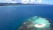 Slow descending aerial view of small sand island near Buen Hombre in the Dominican Republic