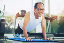Senior Man Push Up In Fitness Gym. Mature Healthy Lifestyle.