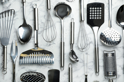 Photo  Different kitchen utensils on marble background, flat lay
