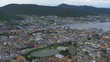 Wide, high view of Bergen, Norway from a nearby mountaintop overlooking the city, fjord, buildings and boats. Bergen is a city on southwestern coast of Norway surrounded by mountains and fjords. PAN.