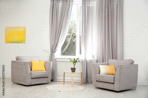 Modern furniture and window curtains in stylish room interior Canvas Print