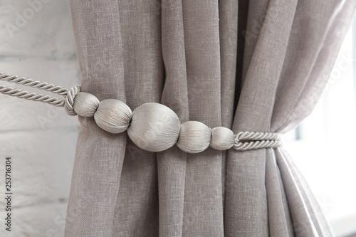Beautiful draped window curtain with tieback in room, closeup Canvas Print