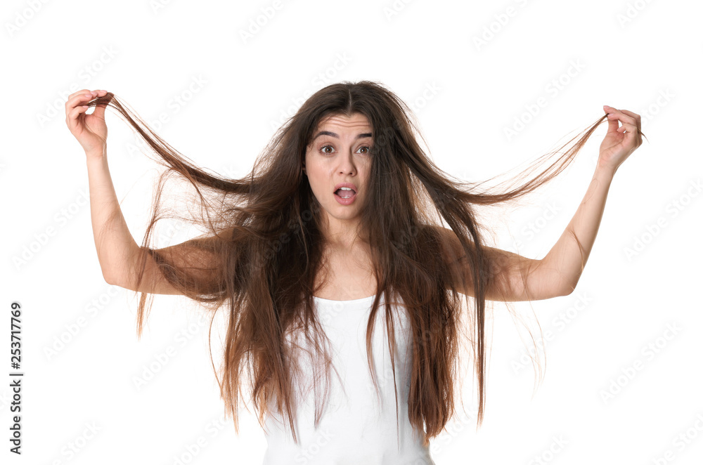 Fototapeta Emotional woman with tangled hair on white background