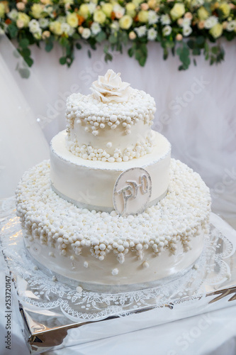 Sweet wedding cake decorated with fresh flowers Canvas Print