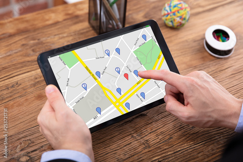 Photo Person Using GPS Map On Tablet