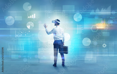 Fotografia, Obraz  Good looking businessman checking reports and charts with vr glasses